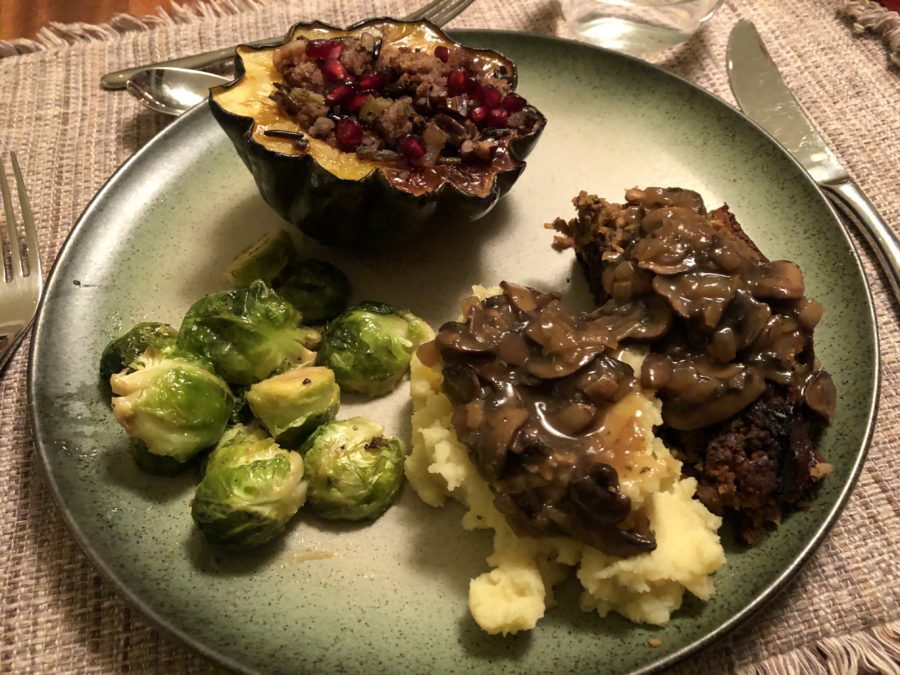 A plant-based Thanksgiving feast: Lentil loaf, stuffed acorn squash, maple-Dijon roasted brussel sprouts topped with mushroom gravy.